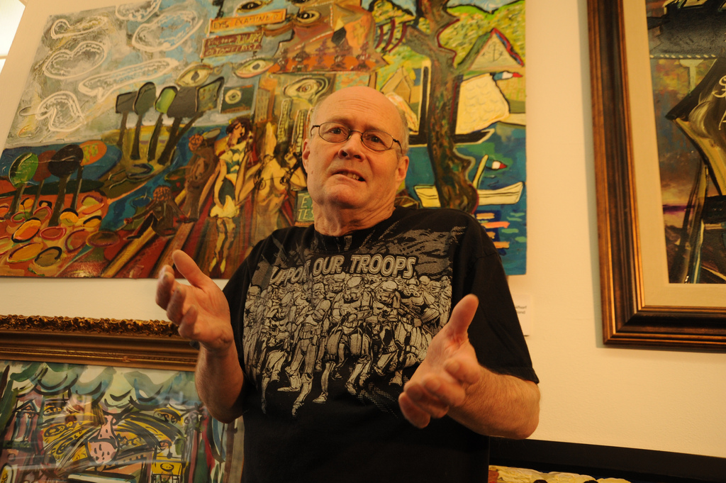 Karl Krogstad, shrugging gesture, in black Support Our Troops (Storm Troopers) T-shirt, fashion, fine artist, paintings, Ballard, Seattle, Washington, USA